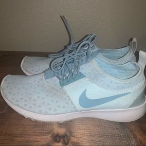 Light blue Nike running shoes